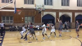 Divine Child with a win over Loyola, 72-55