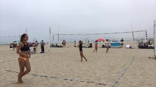 Buchner/Brennan victorious over Naess/Bouquet, 21-13