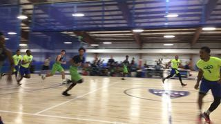 MD Dfenders Varsity gets the victory over iWork Basketball, 65-64