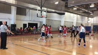 TMK (Red) triumphant over Liberty Pumas, 49-37